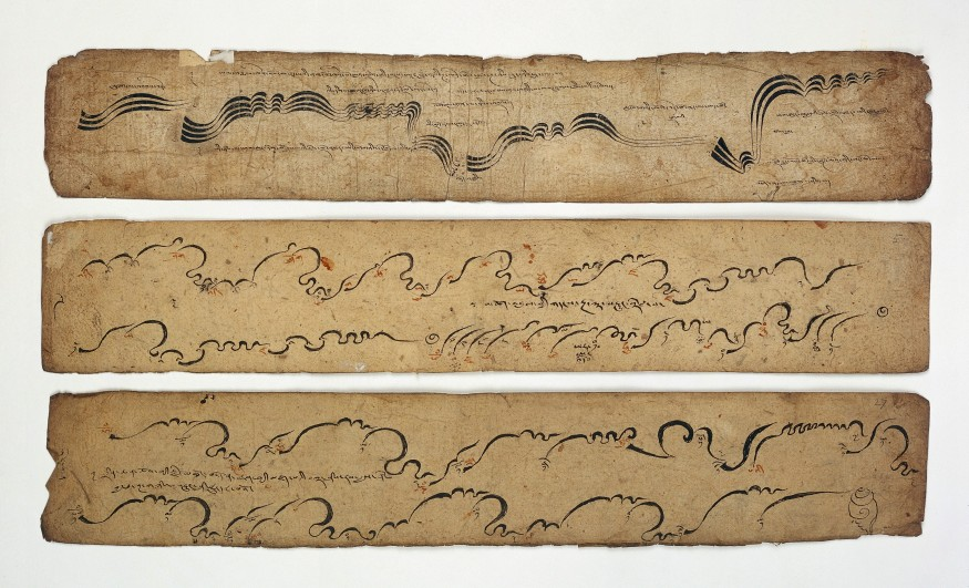 L0032693 Tibetan MS 42, leaves from a musical score Credit: Wellcome Library, London. Wellcome Images images@wellcome.ac.uk http://wellcomeimages.org Three leaves from a Tibetan musical score used in Buddhist monastic ritual with the notation for voice, drums, trumpets, horns and cymbals. Published: - Copyrighted work available under Creative Commons Attribution only licence CC BY 4.0 http://creativecommons.org/licenses/by/4.0/